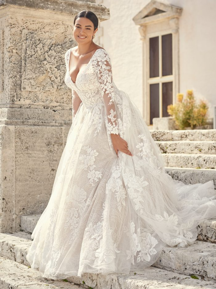 Bride Wearing Long Sleeve Floral Lace Wedding Gown Called Valona by Sottero and Midgley