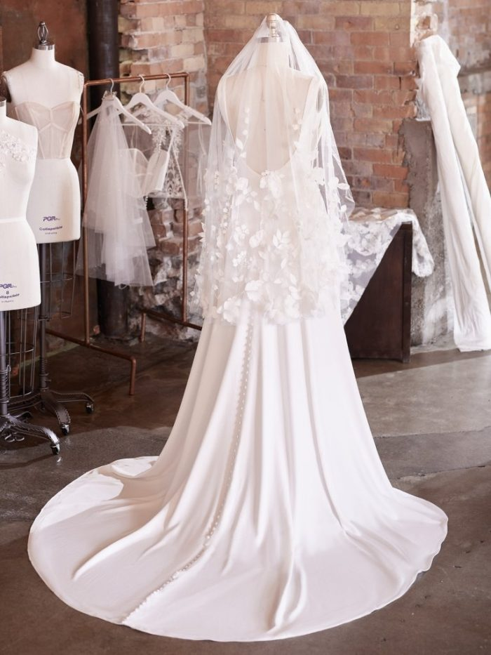 Mannequin Wearing Fingertip Wedding Veil with 3-D Flowers Called Lavinia by Maggie Sottero