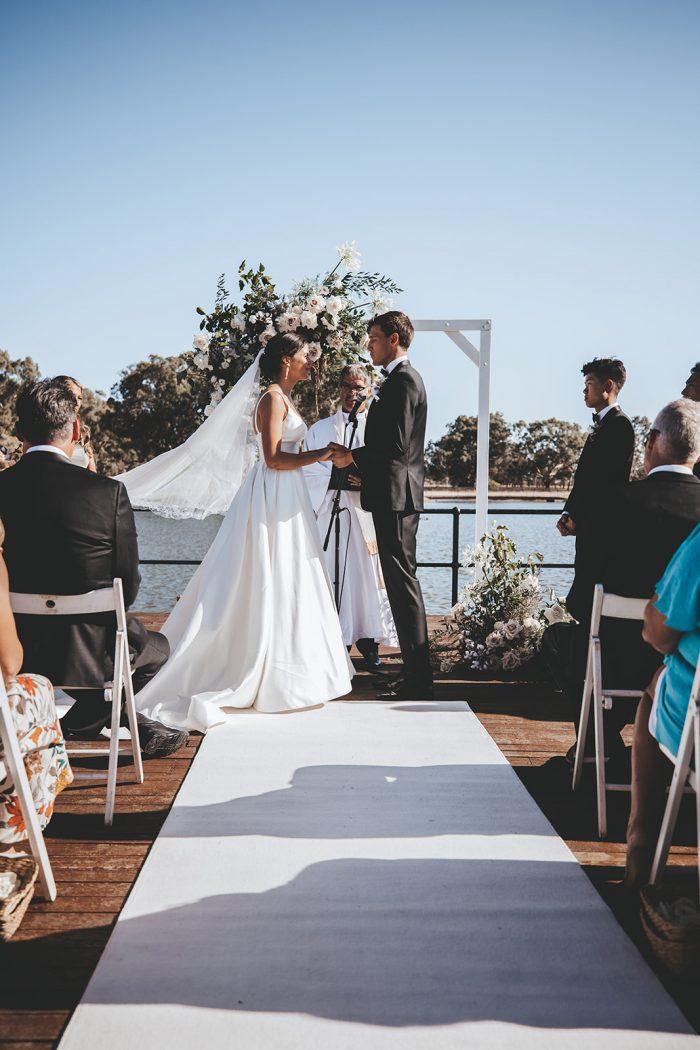 Bride and Groom Saying Vows During Vineyard Wedding in Western Australia's Swan Valley Wine Region