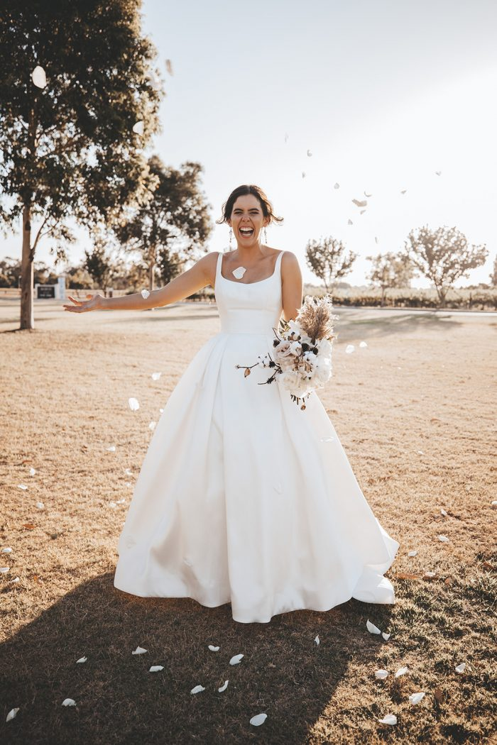Bride Wearing Modern Square Neck Satin Wedding Gown Called Selena by Maggie Sottero