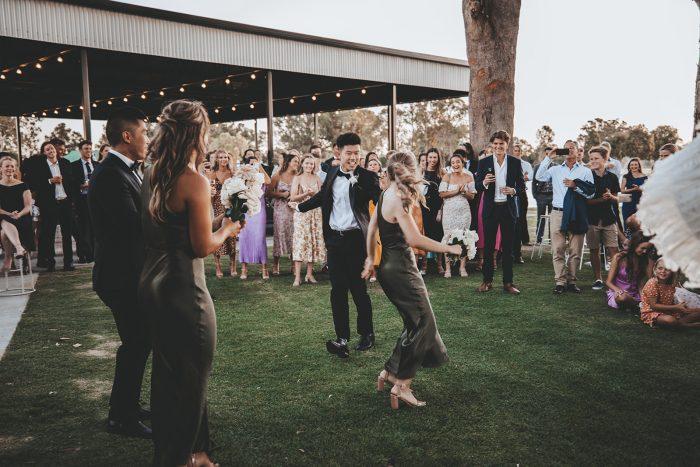 Bridesmaids and Groomsmen Dancing at Wedding Reception at Vineyard Wedding