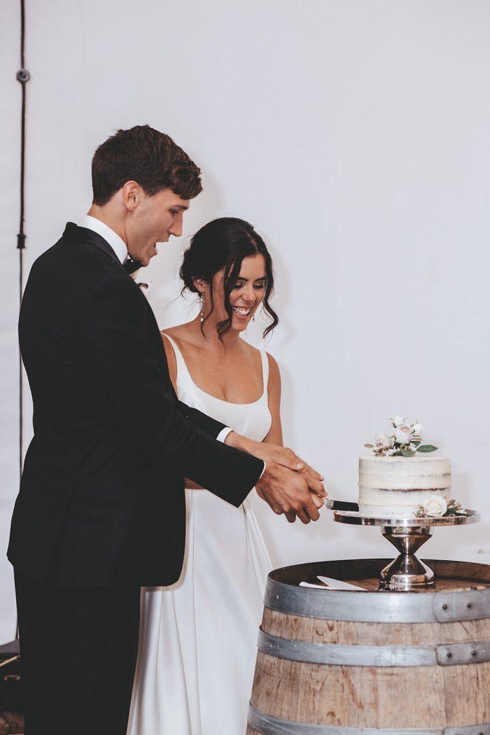 Bride and Groom Cutting Chocolate Wedding Cake at Vineyard Wedding