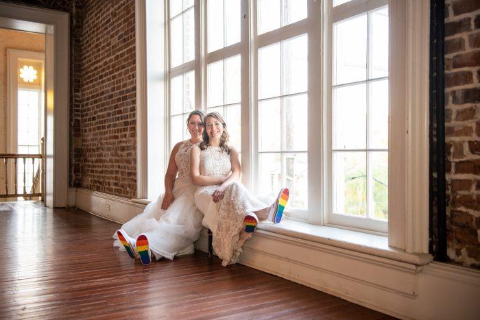 Real Brides at LGBTQ Wedding Wearing Rainbow-Showed Shoes for Pride Wedding Idea
