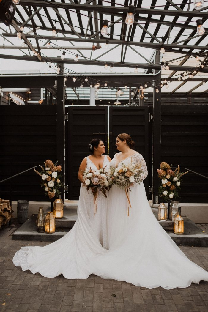 LGBTQ Brides Holding Matching Bouquets While One Bride Wears Maggie Sottero Wedding Dress Mallory Dawn