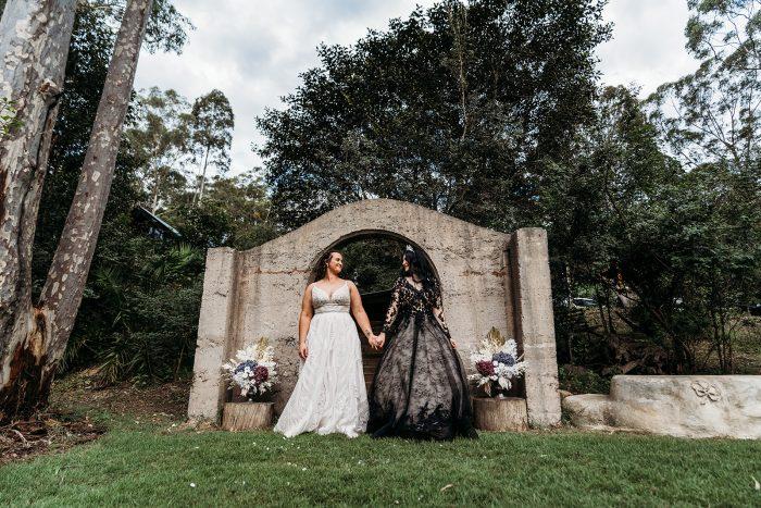 LGBTQ Brides at Vintage Fairytale Wedding Wearing Maggie Sottero Wedding Dresses