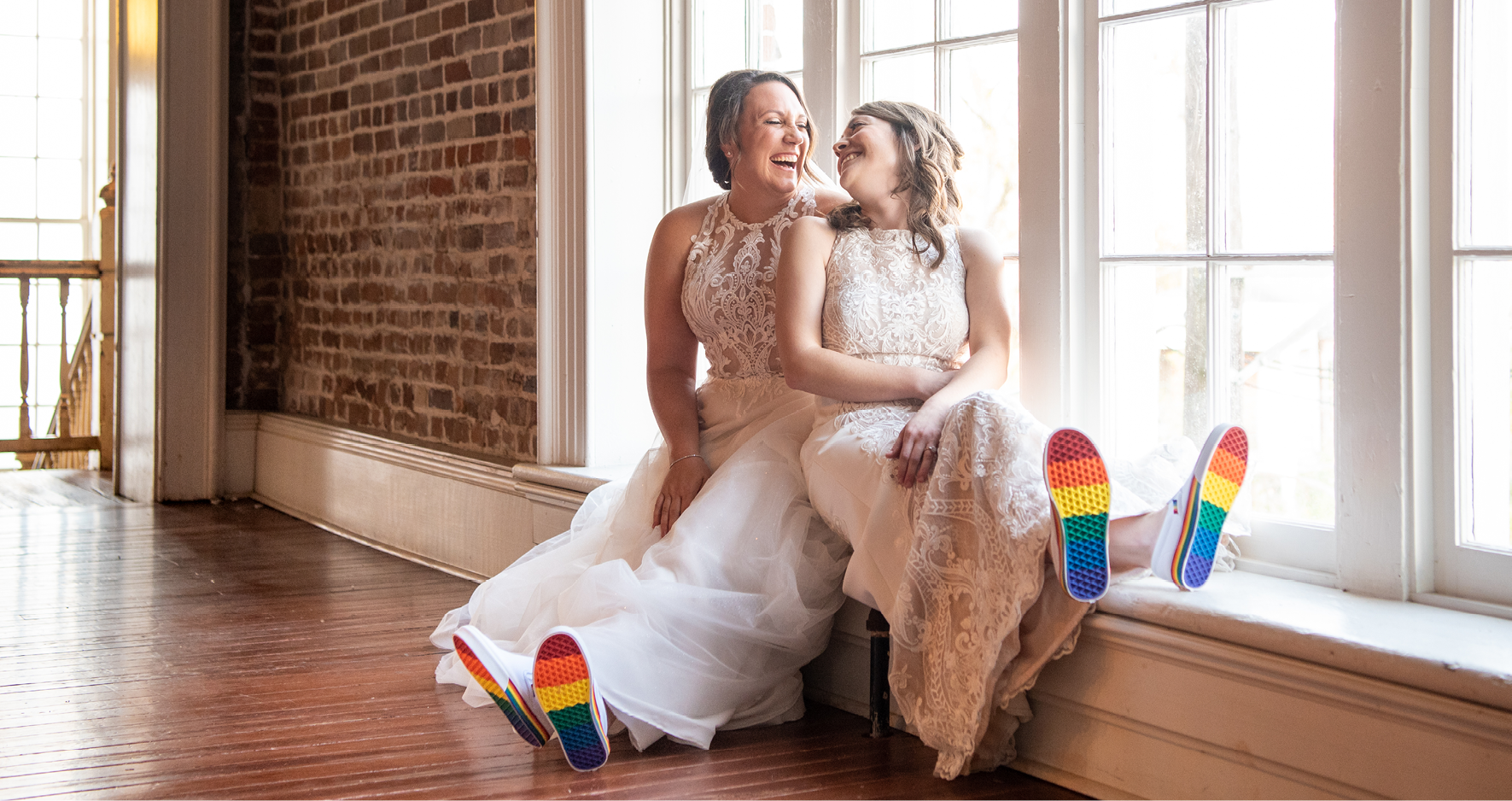 LGBTQ Brides Sitting Together and Wearing Rainbow-Soled Shoes for Pride Wedding Idea