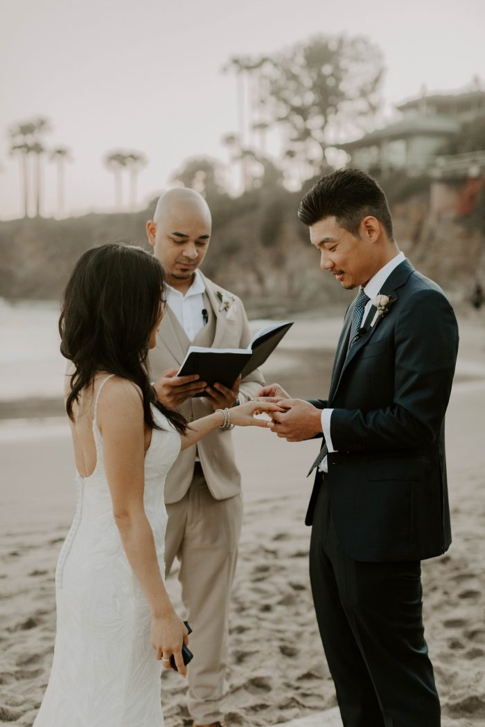 Bride and Groom Exchanging Rings at Casual Beach Wedding