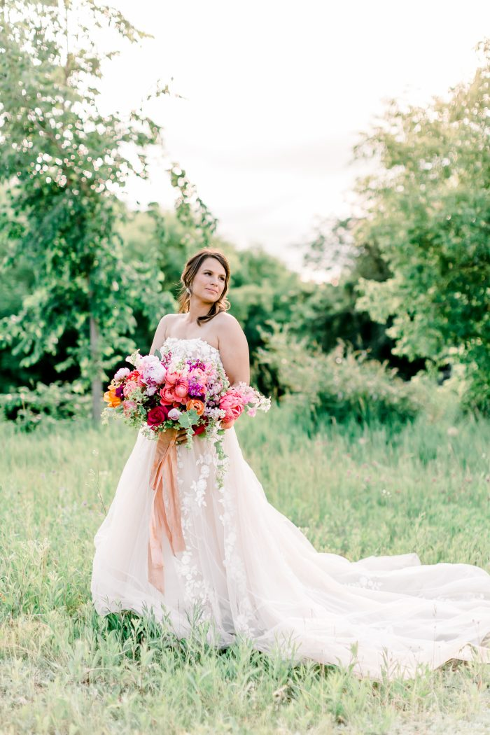 Real Bride Wearing Floral Cottagecore Wedding Dress in the Forest Called Zareen by Maggie Sottero