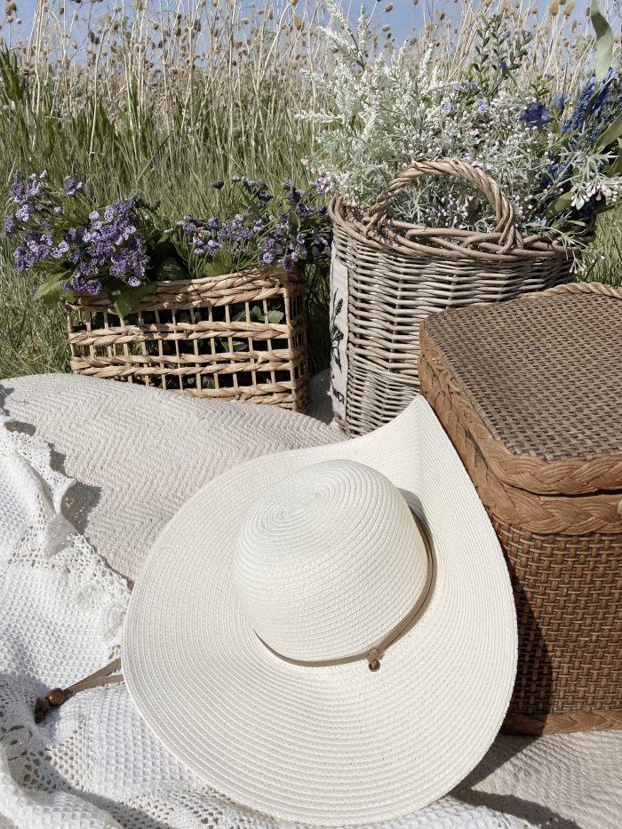 Cottagecore Picnic with Sunhat and Flowers in Field