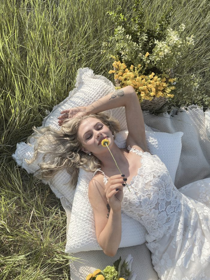 Bride Laying Down at Picnic and Wearing Cottagecore Wedding Dress Called Sawyer by Sottero and Midgley