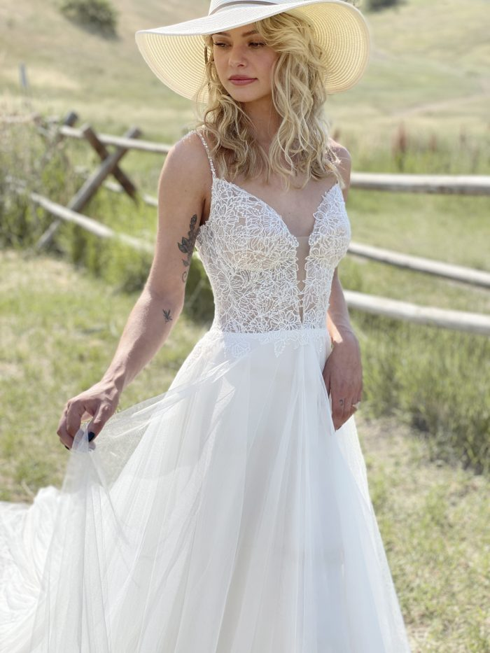 Bride in Field Wearing Chiffon A-line Cottagecore Wedding Dress Called Greta by Rebecca Ingram