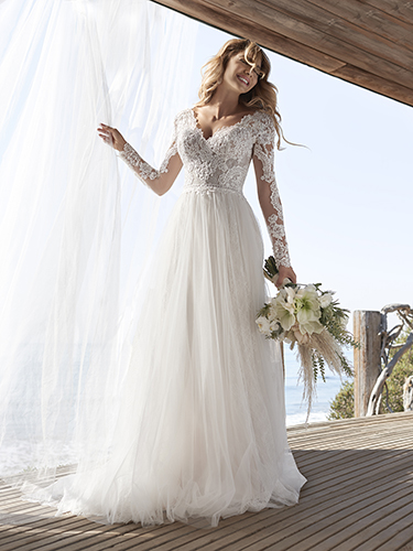 Bride Wearing Lace Long Sleeve Cottagecore Wedding Gown Called Iris by Rebecca Ingram