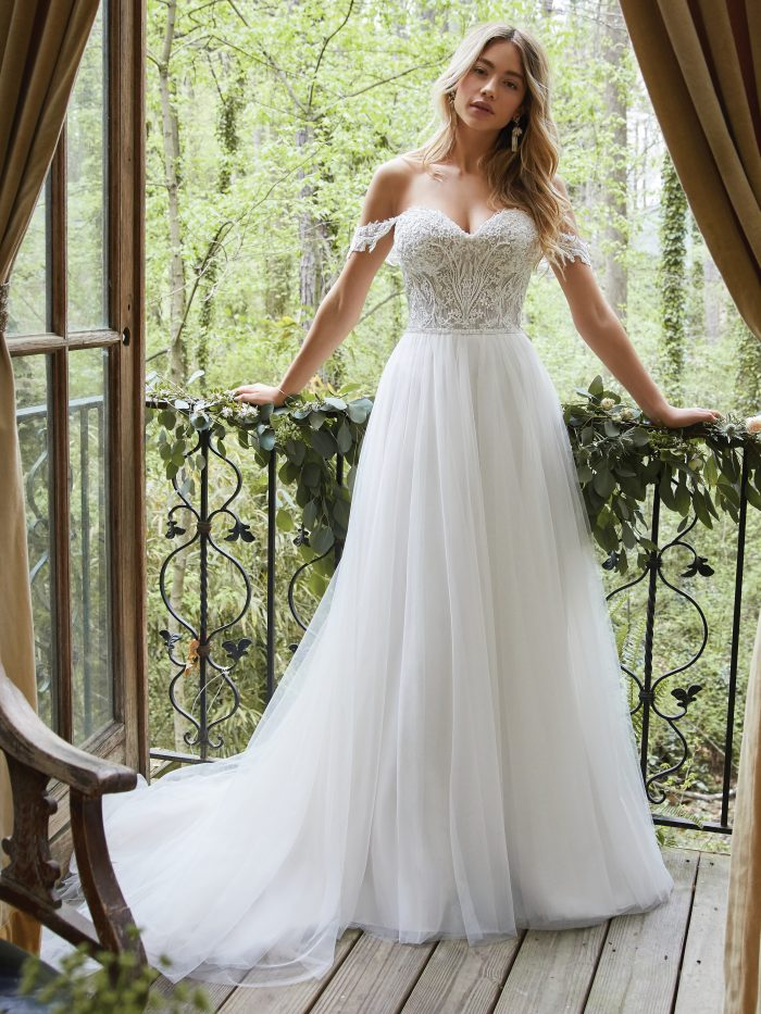 Bride Wearing A-line Cottagecore Wedding Dress Called Nia by Rebecca Ingram in the Forest