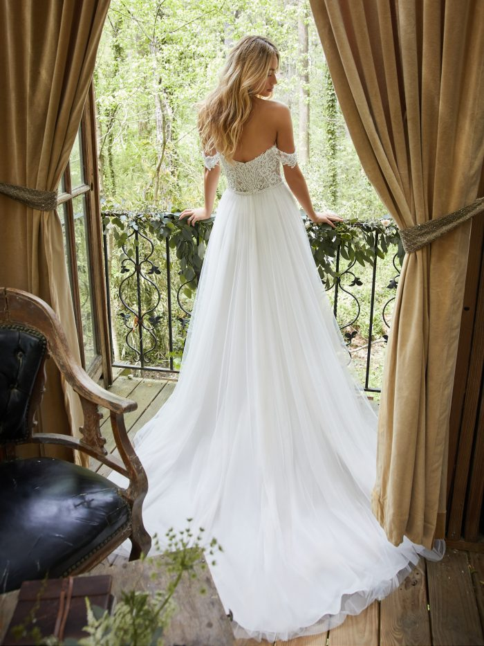 Bride in Cottage Wearing Cottagecore Wedding Dress with Off-the-Shoulder Sleeves Called Nia by Rebecca Ingram