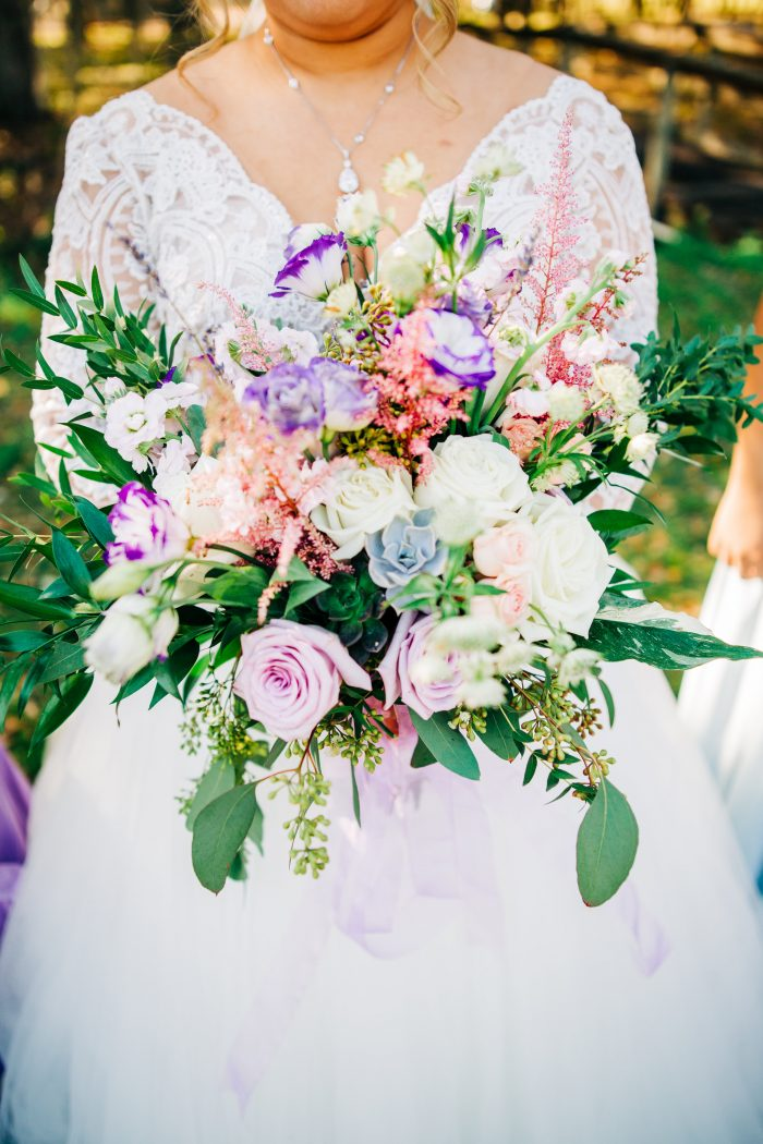 Bride Holding Bouquet Featuring Lavender and Blue Summer Wedding Color Palette