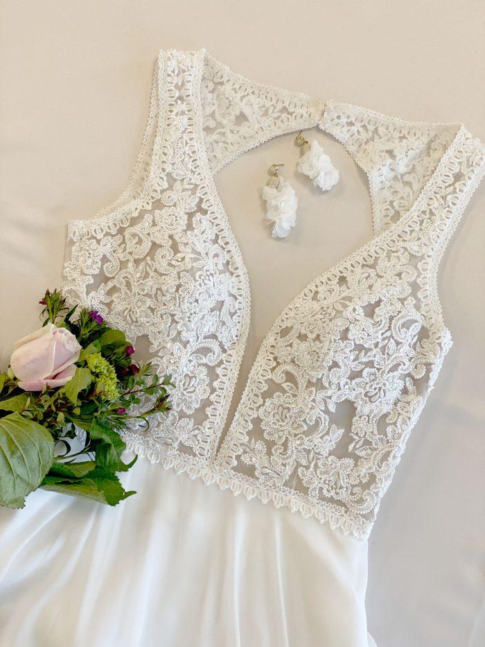 Flat Lay of Rustic Chiffon Wedding Gown Called Gabriella by Rebecca Ingram