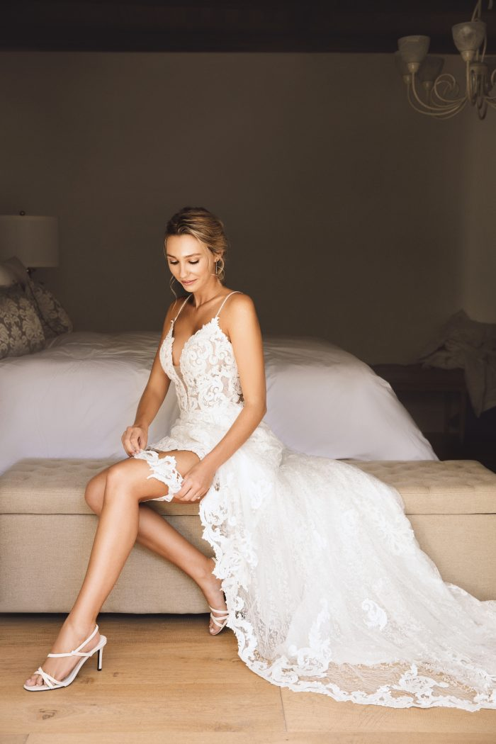 Bride Wearing Wedding Garter and Lace Sheath Wedding Dress Called Tuscany Lynette by Maggie Sottero