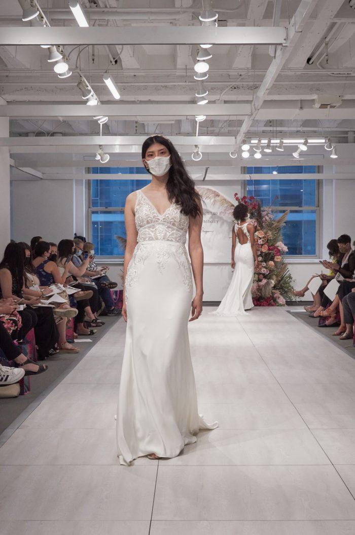 Model Walking on Runway Wearing V-neck Sheath Wedding Dress Called Calista by Maggie Sottero