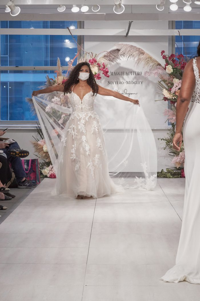 Model at Chicago Bridal Market Wearing New Runway Wedding Dress with Florals Called Evora by Rebecca Ingram