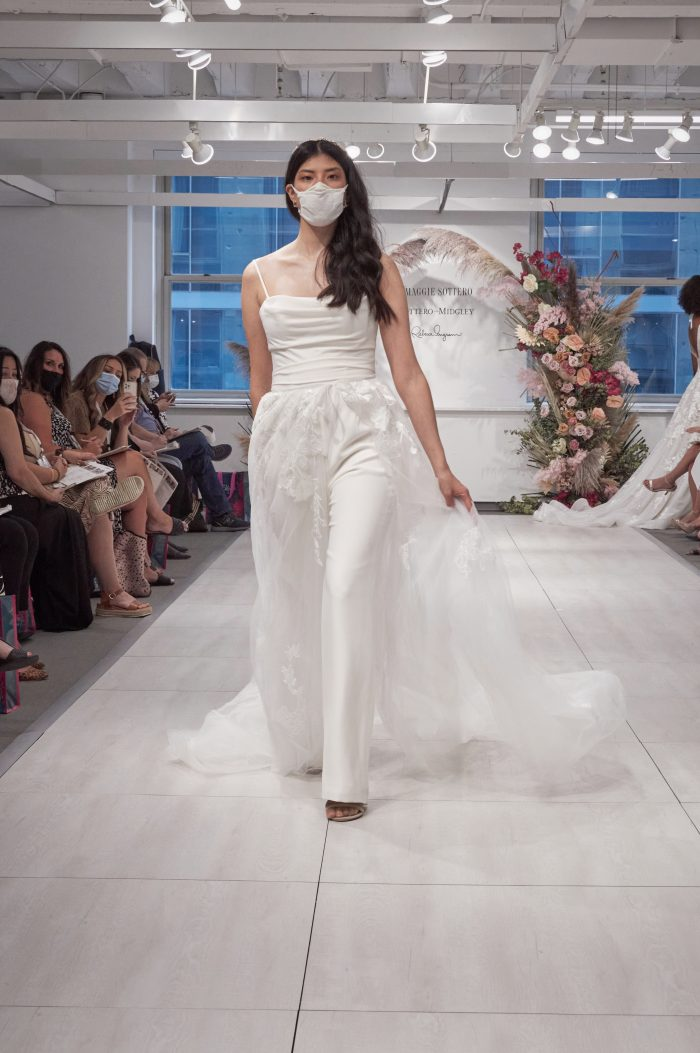 Model Wearing Bridal Jumpsuit Called Gibson by Maggie Sottero While Walking Down Runway