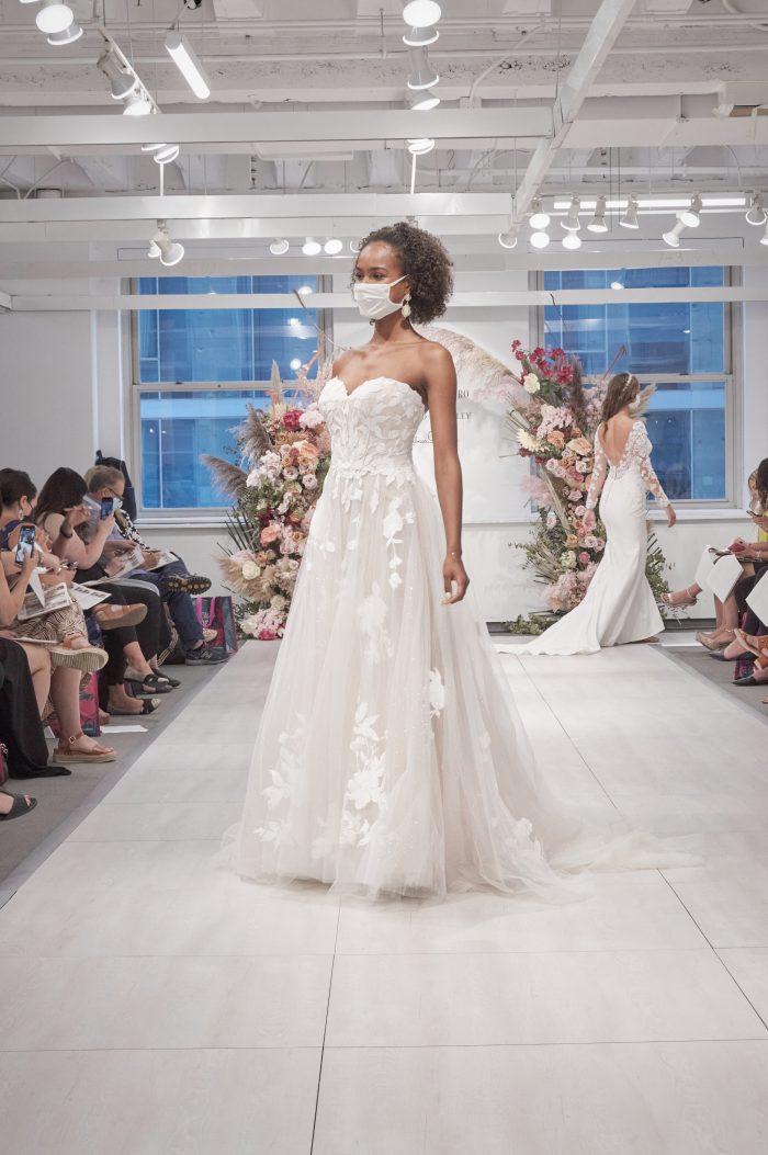 Bride Wearing Strapless A-line Wedding Gown Called Hattie Lane Lynette at Chicago Bridal Market