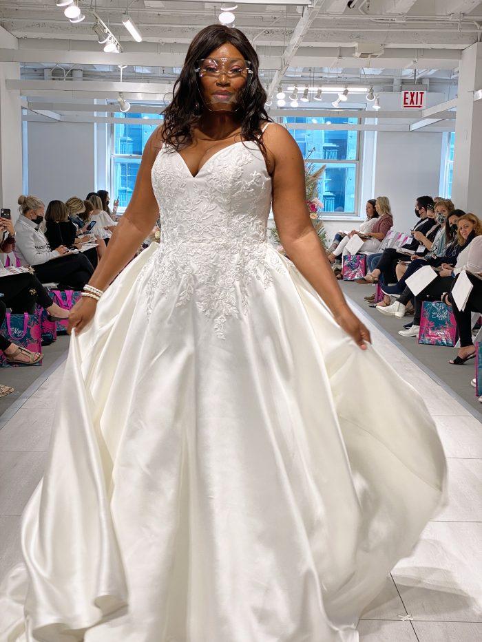 Model Walking Down the Runway at Chicago Bridal Market Wearing Plus Size Wedding Dress Called Iona by Rebecca Ingram
