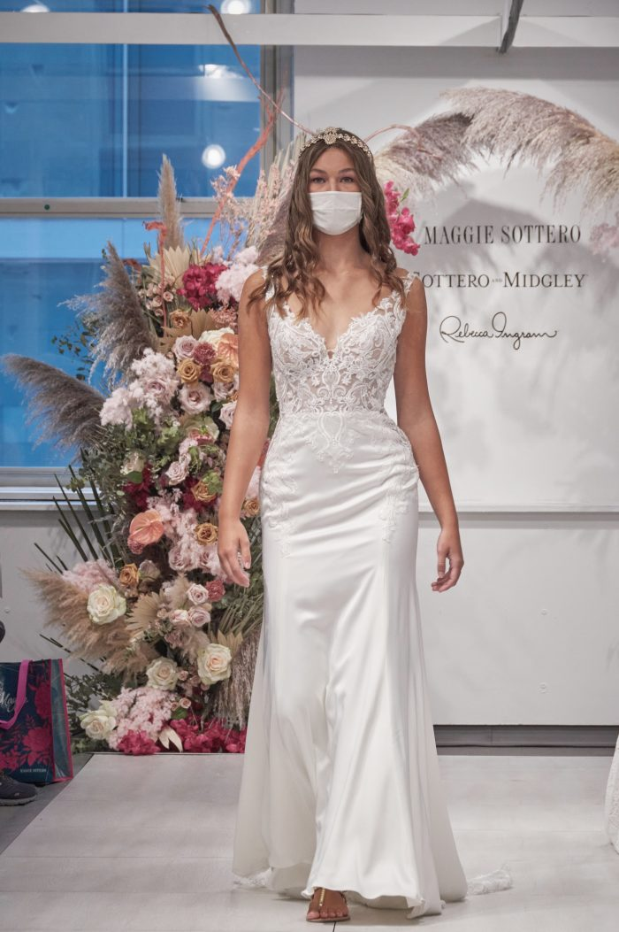 Model Walking Down the Runway Wearing Lace Crepe Sheath Bridal Gown Called Mayuri by Maggie Sottero