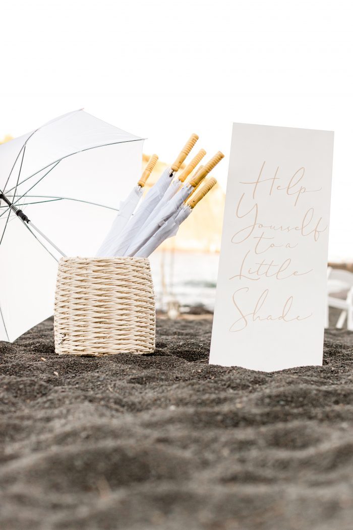Umbrellas and Parasols to Shade Guests from Sun at Outdoor Beach Wedding
