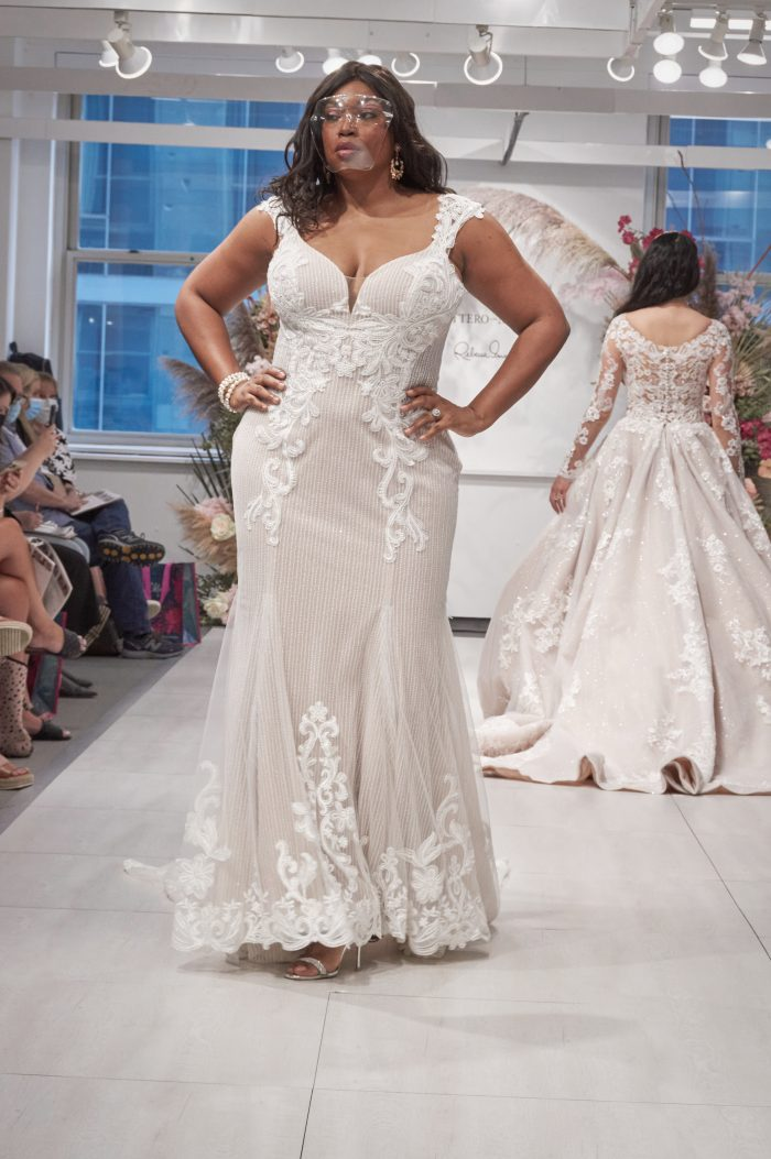 Bride Walking on the Runway in Chicago Wearing Plus Size Sheath Wedding Gown Called Rashida by Sottero and Midgley