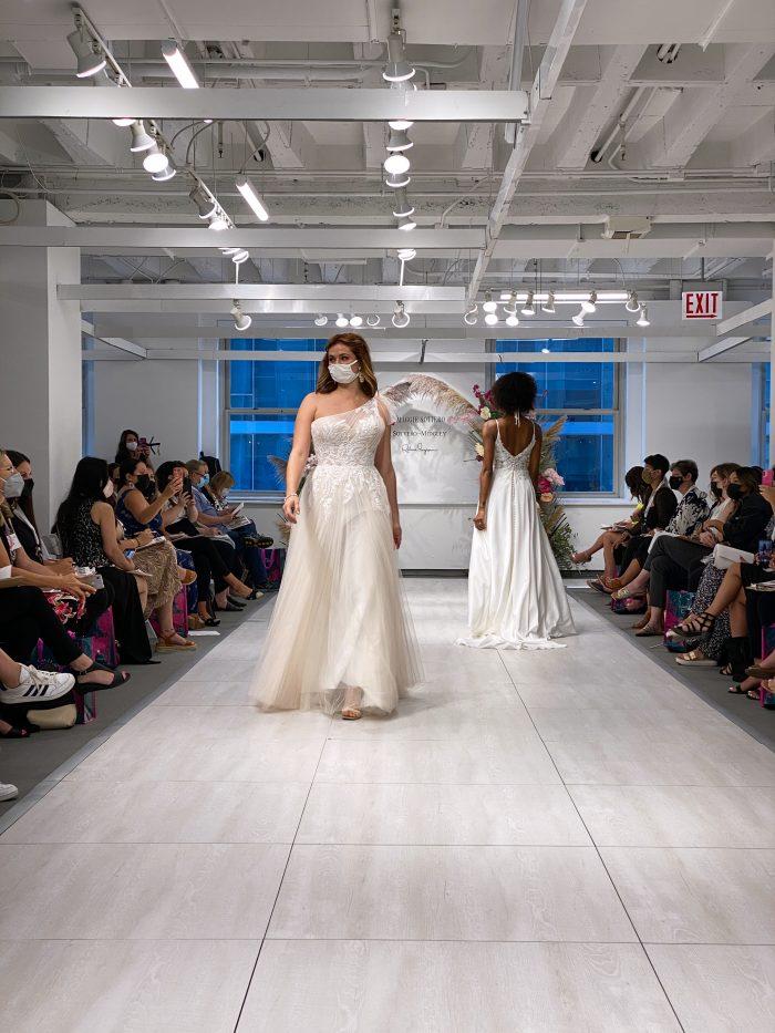 Model Walking on the Runway at Chicago Bridal Market Wearing One-Shoulder Wedding Dress Called Winnie by Rebecca Ingram