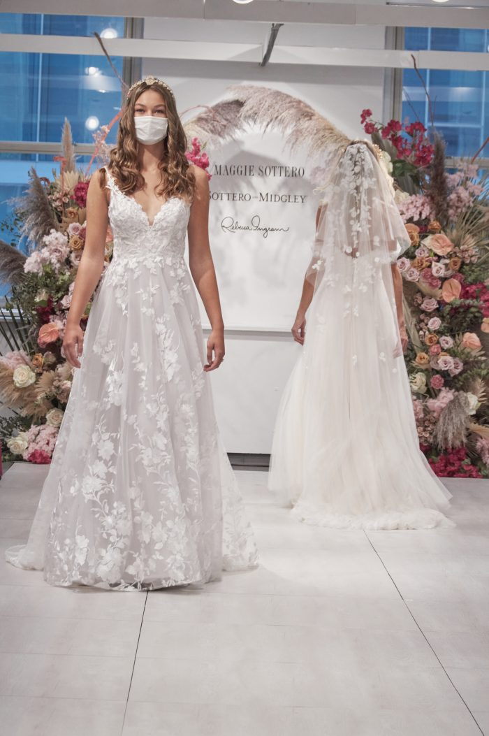 Model Walking Down the Runway at Chicago Bridal Market Wearing Floral A-line Bridal Gown Called Winter by Maggie Sottero
