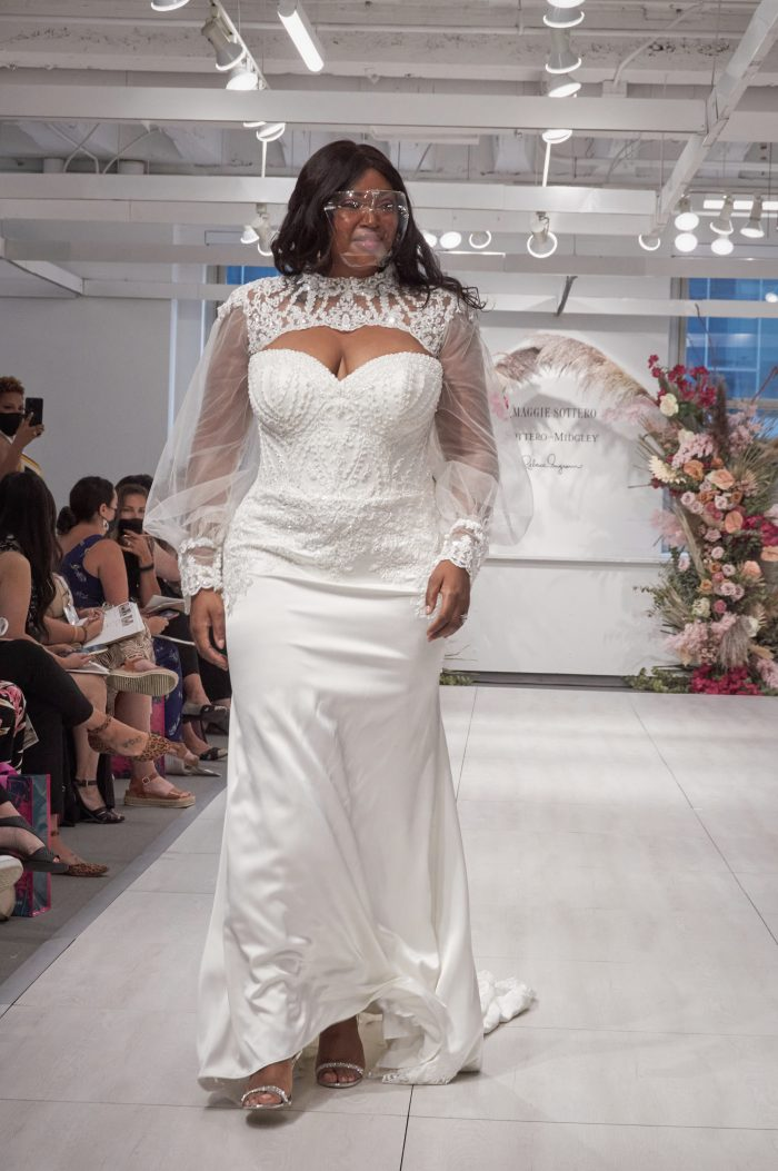Model Wearing Plus Size Sophisticated Runway Wedding Dress with Bishop Sleeve Bridal Jacket Called Yates by Maggie Sottero
