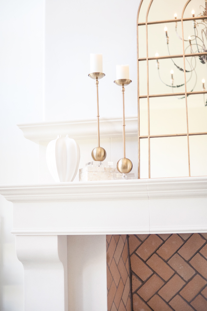 gold-candle-holders-fireplace