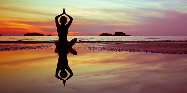 girl doing yoga on Tamarindo beach