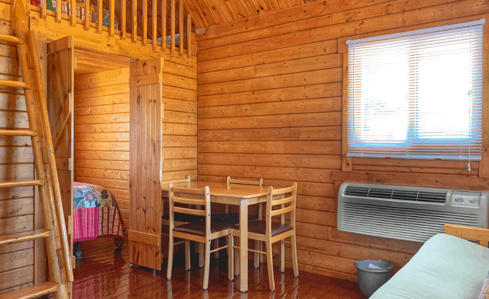 Image of the open living and dining area in your Hill Country cabin rental at our Family Friendly Texas Lake Resort