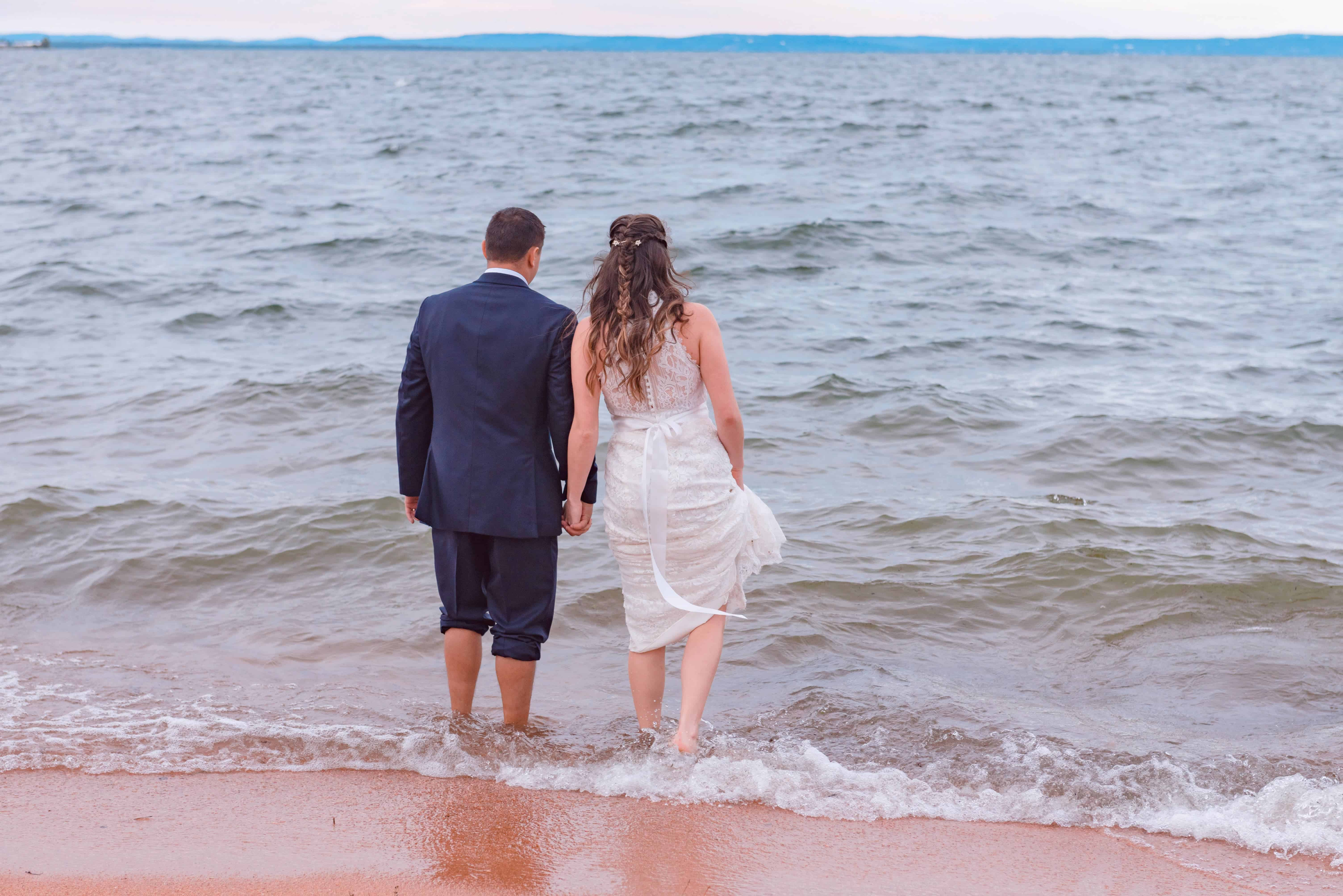 Image of couple who had their wedding at our texas hill country resort walking into Lake Buchanan